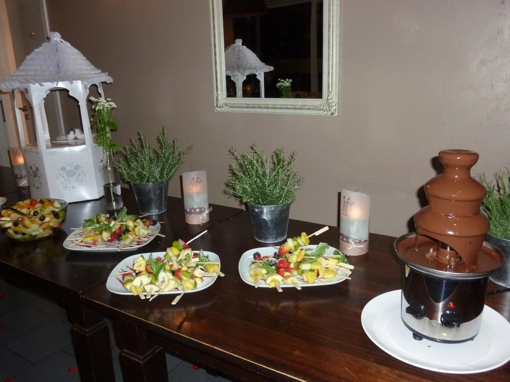 table with fruits and chocolate flow & Chocolate Fountain Reviews \u2013 Which Is The Best? | Boca De Fresa